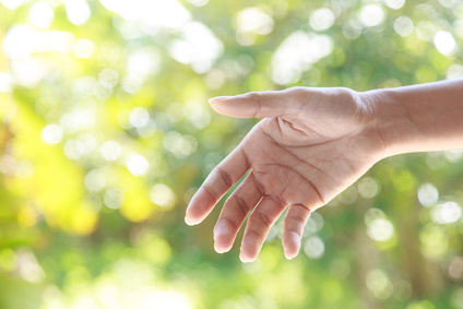 Helping hands  against nature background